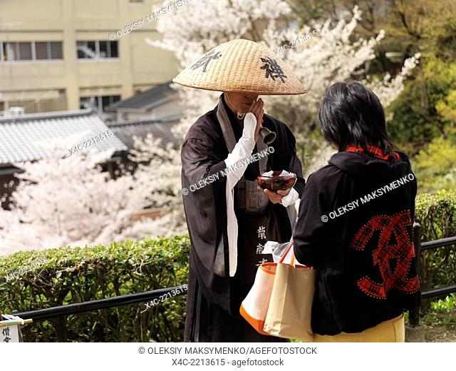 Mendicant Buddhist monk accepting donations. Kyoto, Japan