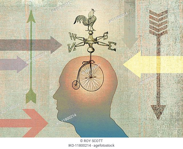 Man thinking about direction with bike wheels, weather vane and arrows