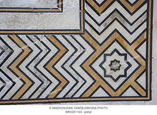 Marble inlay work of interlocking designs on wall of Taj Mahal Seventh Wonders of World , Agra , Uttar Pradesh , India UNESCO World Heritage Site