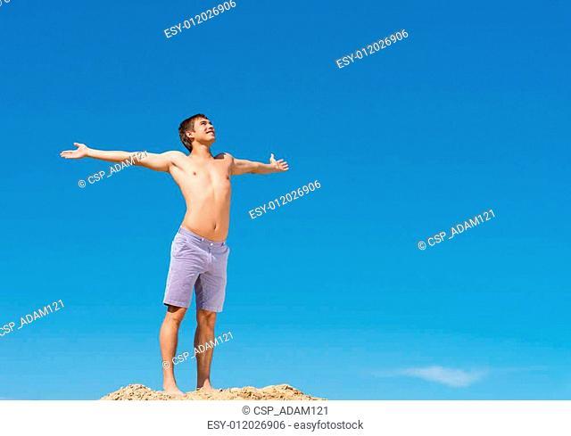shirtless man against blue sky