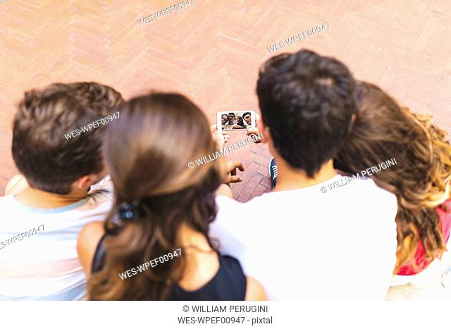Friends taking a selfie with a cell phone