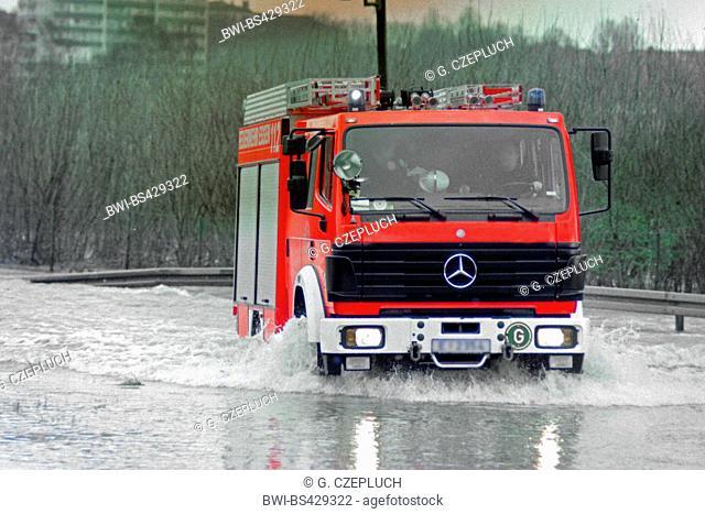 fire brigade car passing through high water, Germany, North Rhine-Westphalia