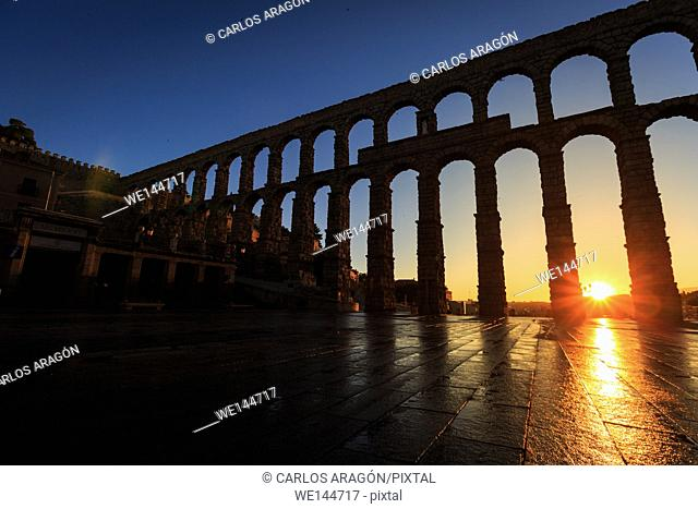 Sunrise between the arches of the Aqueduct of Segovia, Segovia, Spain