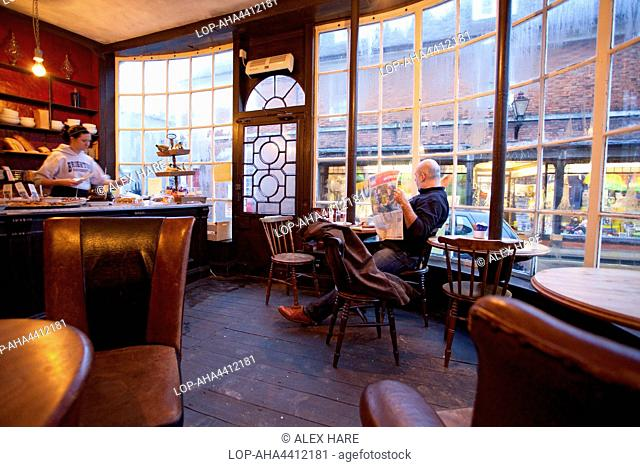 A man relaxes in the Apothecary cafe in Rye