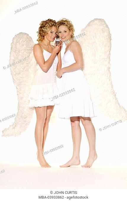 Women, young, blond, angel wings, smiling, telephones cheerfully, cell phone, together, barefoot, christmas, people, christmas-angels, angels, angels, sisters