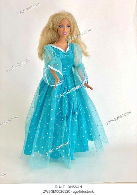 Blond Barbie doll in a blue clothes