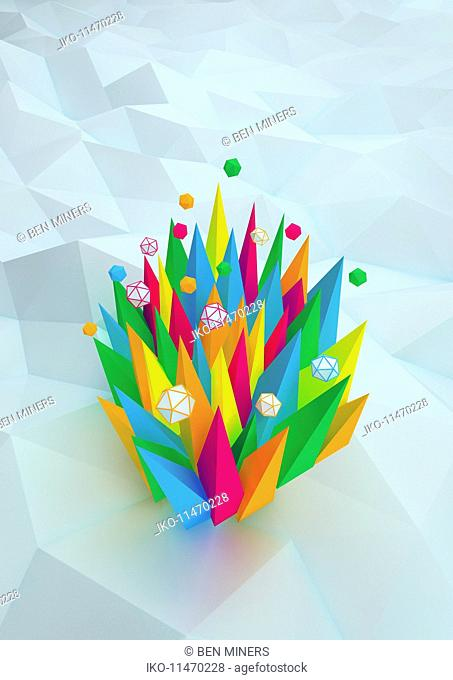 High angle view of abstract bright color spikes and three dimensional geometric shapes