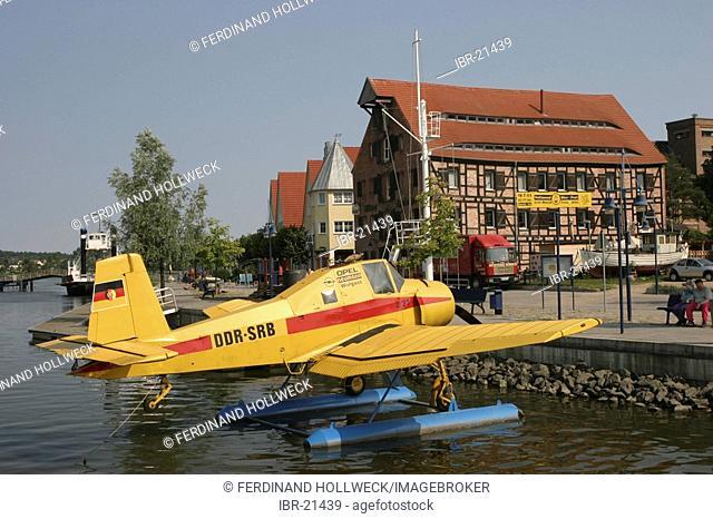 BRD Germany Mecklenburg Vorpommern Wolgast harbour with plane and building