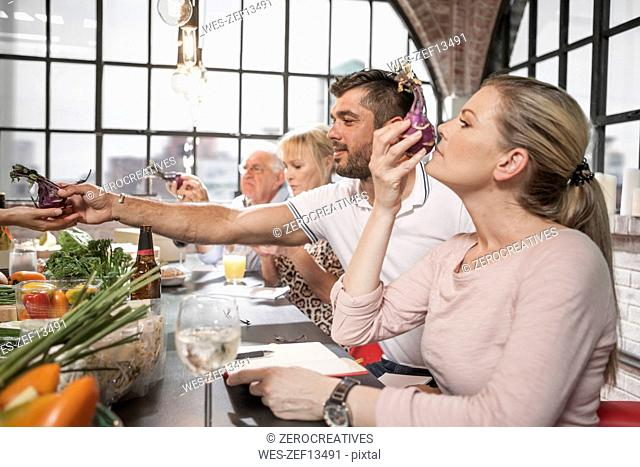 Students in cooking class examining beetroot