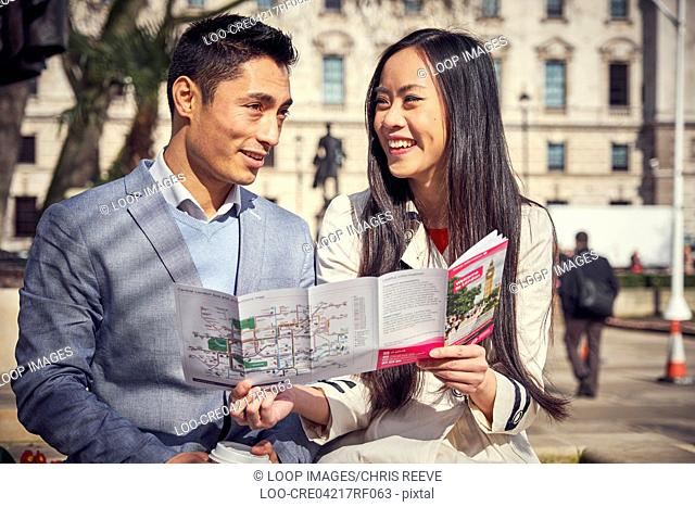 A young Japanese couple sightseeing in London