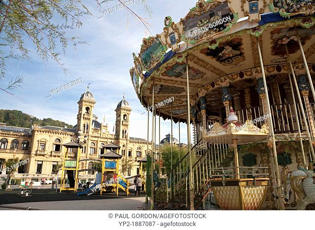 Carousel in the Gardens of Alderdi-Eder in the parte vieja - San Sebastián , Gipuzkoa, Basque Country, Spain  The City Council of San Sebastián is in the...