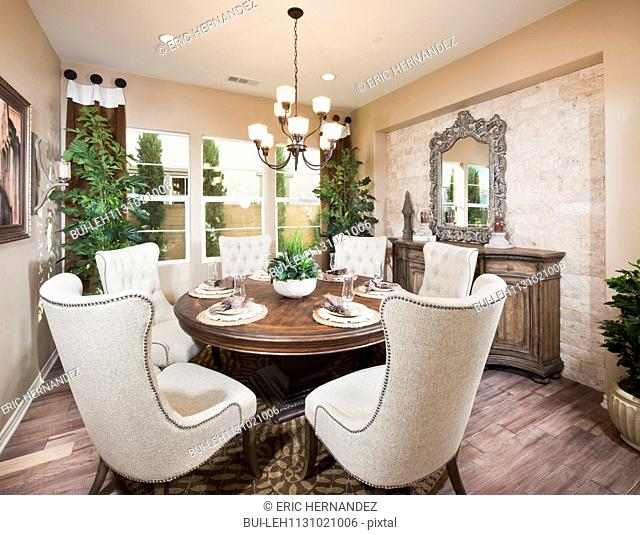 Wingback chairs at dining table in house; Irvine; California; USA