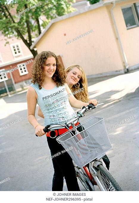 Two teenagers on a schoolyard