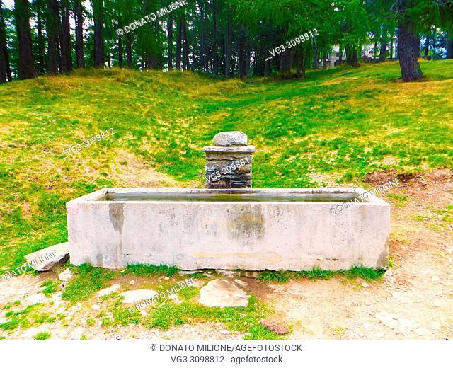 Valvarrone (Lecco), Roccoli di Lorla. The fountain next to the pond, on the slopes of Mount Legnoncino