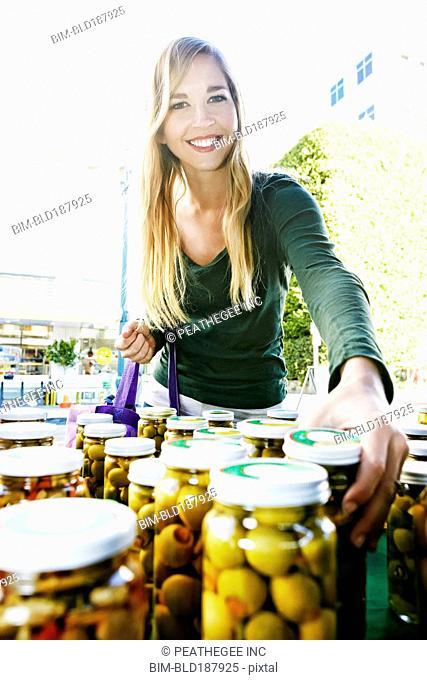Caucasian woman shopping in farmers market