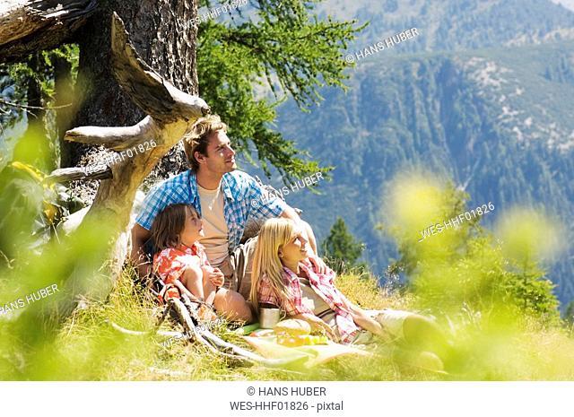 Austria, Salzburger land, parents and son 8-9 having picnic