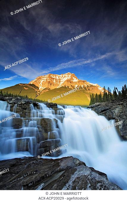 Athabasca Falls with Mount Kerkeslin in the background in early spring, Jasper National Park, Alberta, Canada