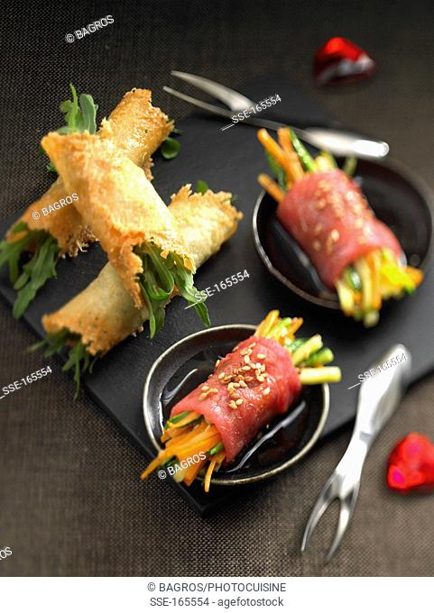 Parmesan and rocket rolls,carpaccio and vegetable appetizers