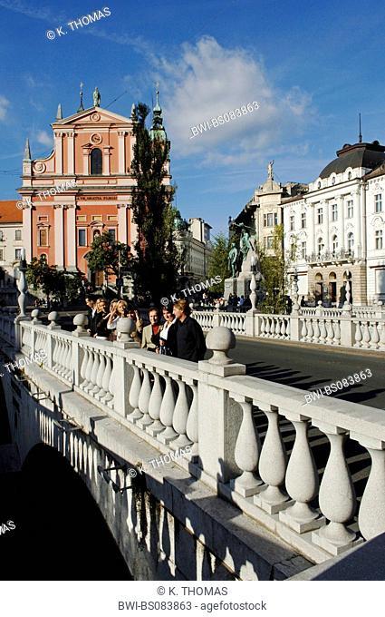 Ljubljana, Tromostovje (Three Bridges, Plecnik), in background Franciscan church at Preseren square, Slovenia, Ljubljana