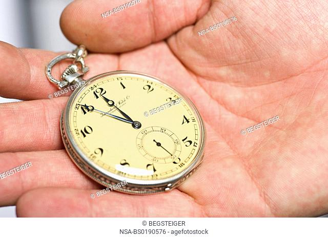 old pocketwatch in hand