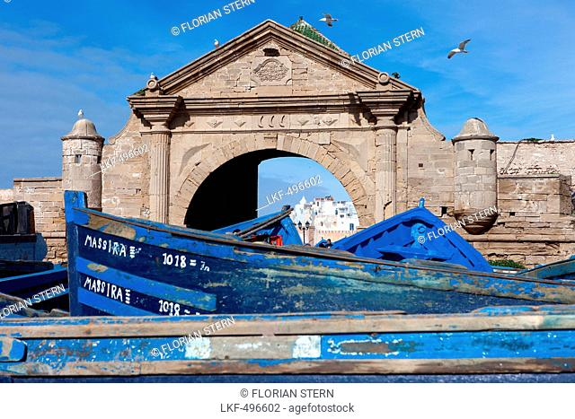 Fishing boats in the harbour of Essaouira with view of the city, Essaouira, Morocco