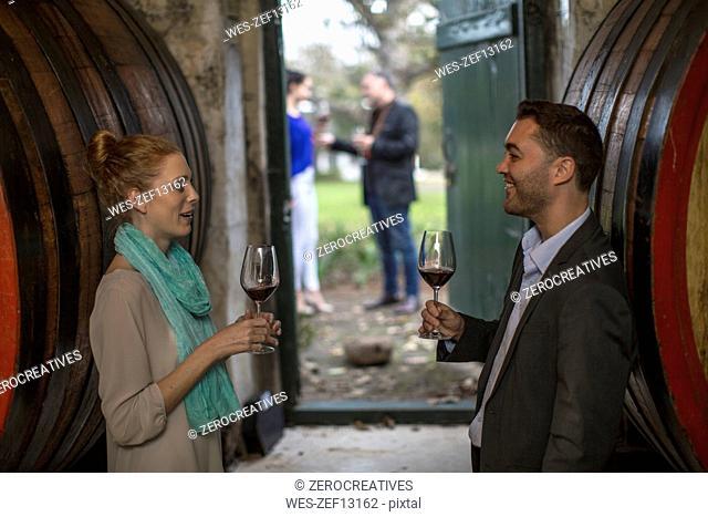 People at a wine tasting at wine estate