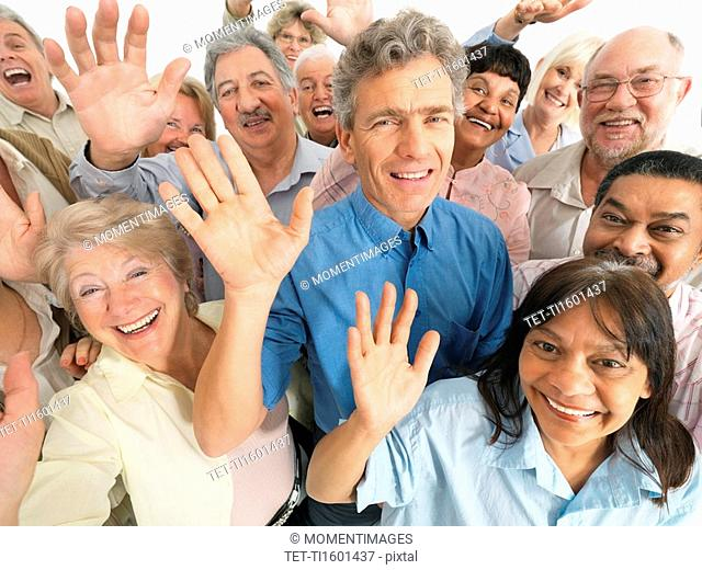 A group of people waving