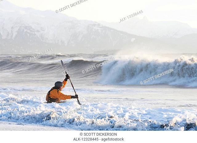 Kayak surfer paddling through rough waters, Kachemak Bay, South-central Alaska; Homer, Alaska, United States of America