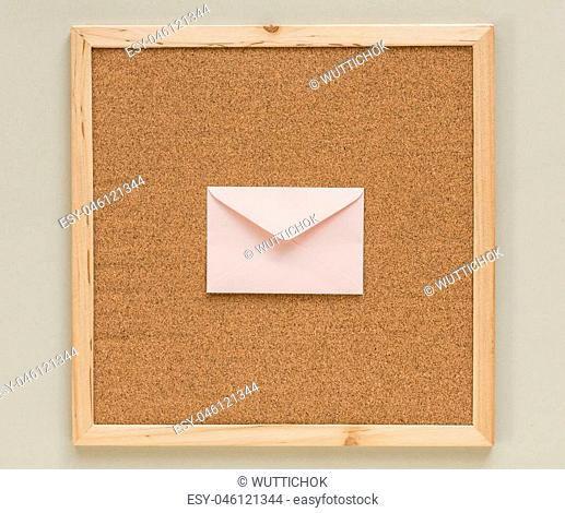 close up white envelope on cork board frame background