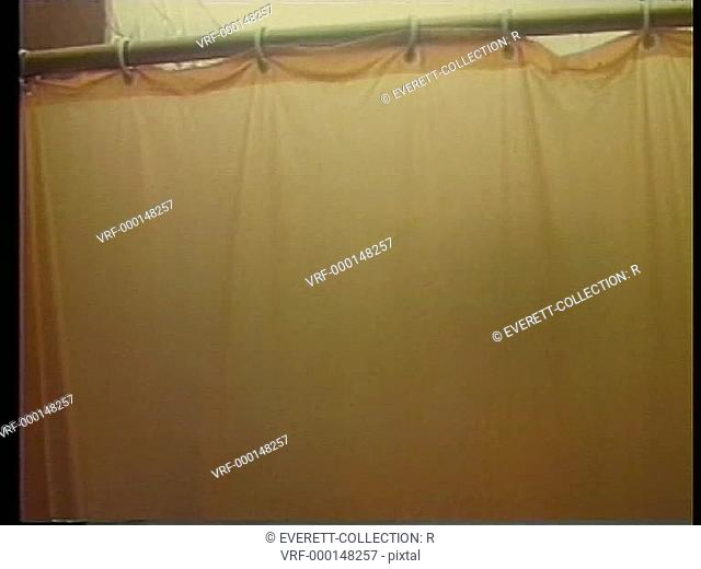 Person moving behind shower curtain