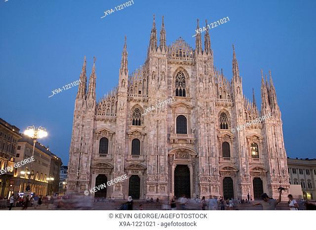 Illuminated Duomo Cathedral Church at night in Milan, Italy