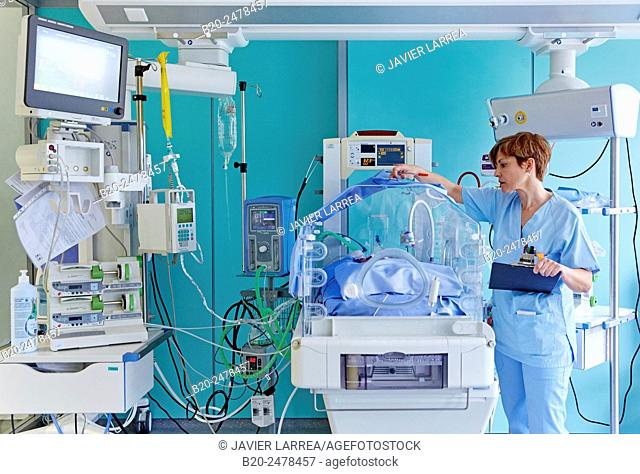 Nurse with incubator in neonatal intensive care unit, Hospital Donostia, San Sebastian, Basque Country, Spain