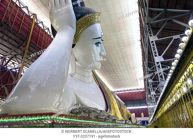 Myanmar (formerly Burma). Yangon (Rangoon). The Kyaukhtatgyi Pagoda is home to a large 70 meter long lying Buddha. His feet plants bear the 108 sacred marks...