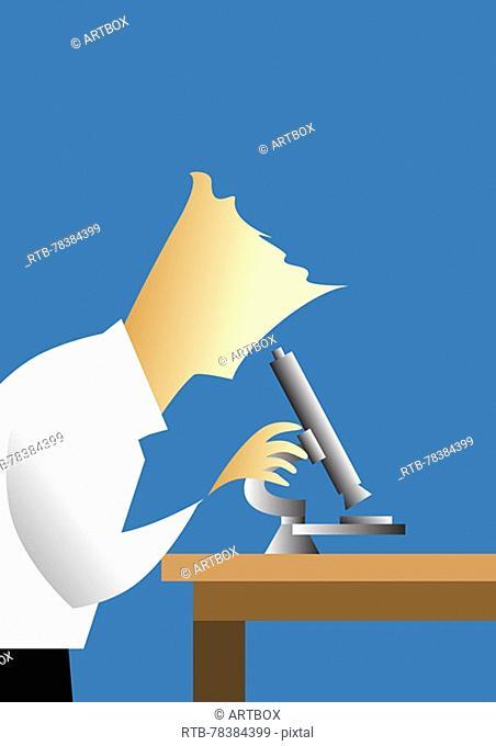 Scientist using a microscope