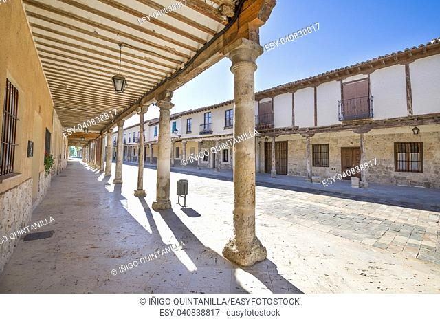 arcaded buildings, in medieval street, landmark and monument from seventeenth century, in Ampudia village, Palencia, Castile Leon, Spain, Europe