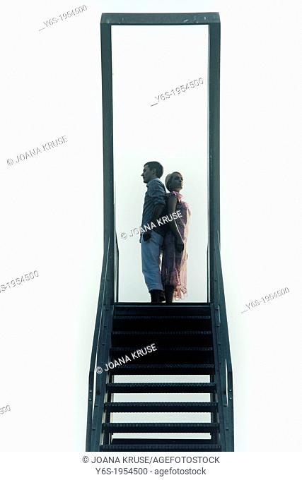 a couple on a diving platform