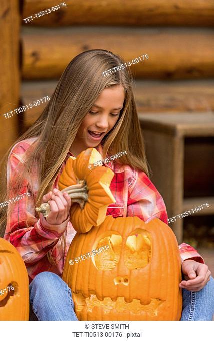 Girl holding Jack O' Lantern