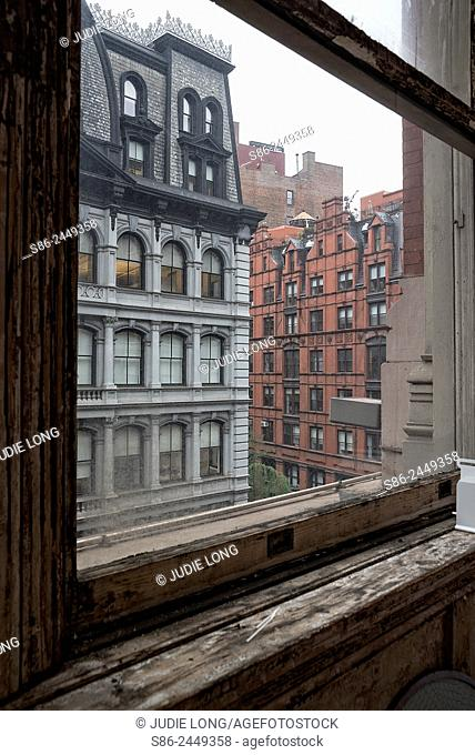 Looking out the window of a Flat Iron building at the Flatiron District of New York City, on a Rainy Day