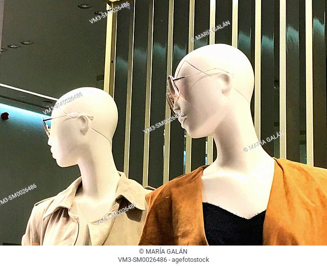 Two mannequins wearing sunglasses in a shop window. Madrid, Spain
