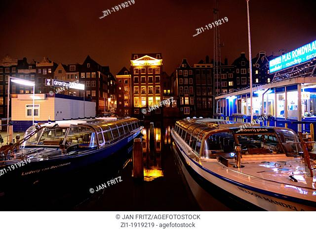 canal boats in Amsterdam by night, the Netherlands