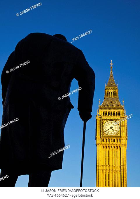 England, Greater London, City of Westminster  Churchill statue and the iconic Big Ben also known as the Clock Tower, part of the House of Parliament building...