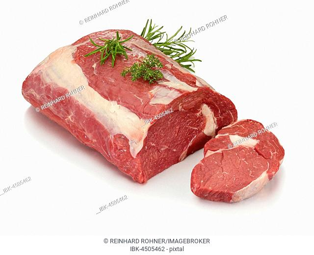 Raw entrecote, beef (Bos primigenius taurus) with rosemary (Rosmarinus officinalis) and thyme (Thymus) as decoration, clipping path available