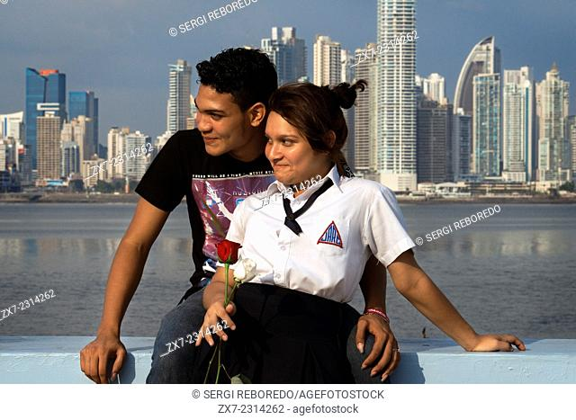 Two students lovers at Cinta Costera in Panama City. Skyline, Panama City, Panama, Central America. Cinta Costera Pacific Ocean Coastal Beltway Bahia de Panama...