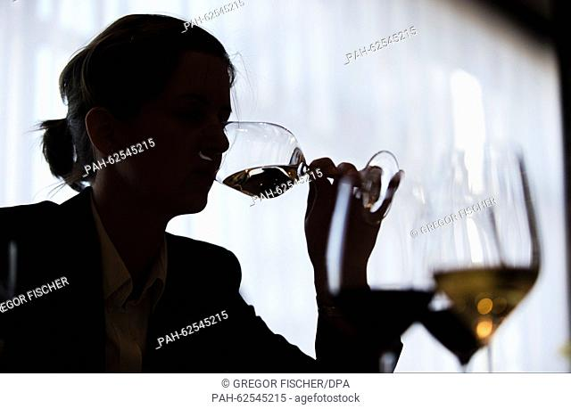 A participant tries a white wine in order to determine the aromas during a wine tasting within the framework of the 2015 Award for Great Hospitality in Berlin