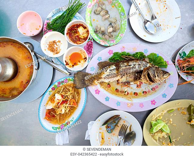 Finish and done Thai spicy food. Fried rice. Tom yum koong soup. Grilled shrimps. Fresh oysters