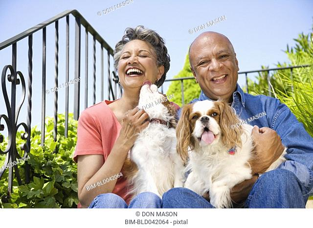 Senior African American couple with dogs