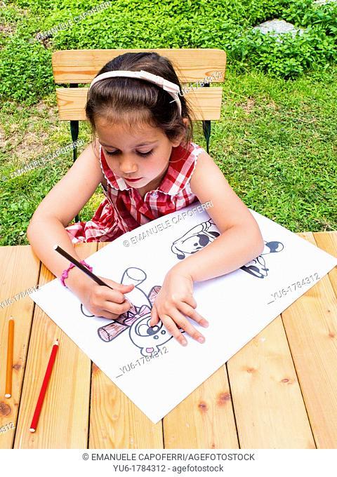 Child draws in the home garden