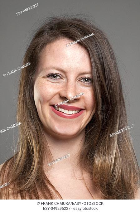 Portrait of a Young Woman with Brown Hair Smiling