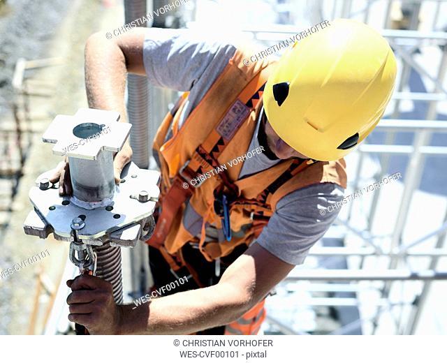 Construction worker fitting pillar