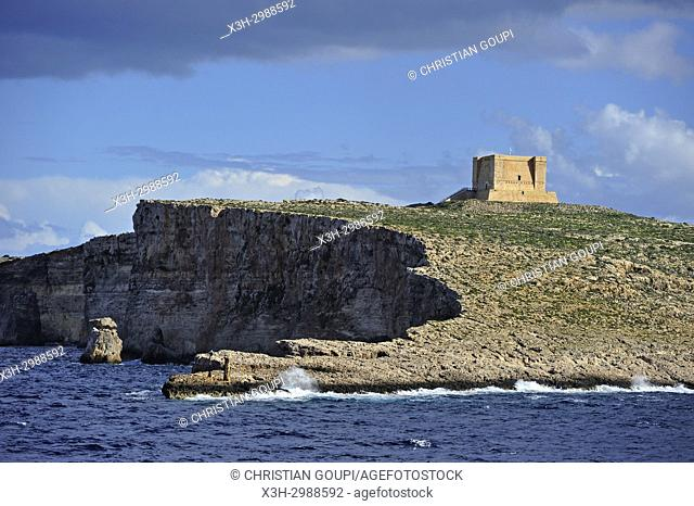 St Mary's Tower on Comino Island seen from the ferry to Gozo Island, Malta, Mediterranean Sea, Southern Europe